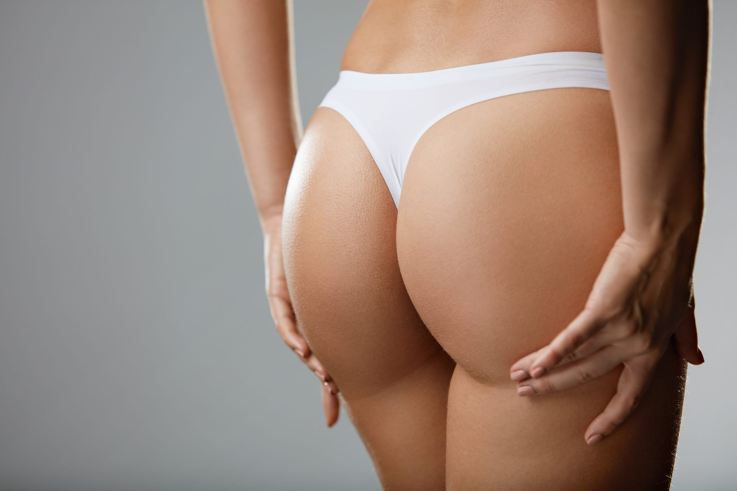 Woman's buttocks photograph by ian hootonscience photo library